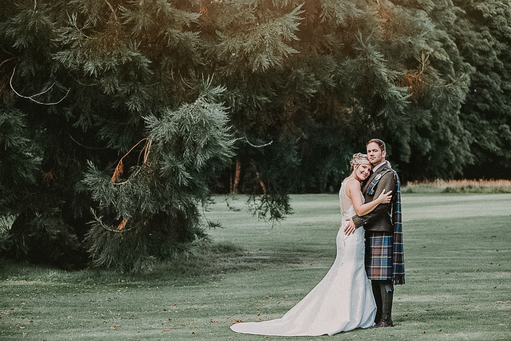 Ardoe House Hotel wedding, bride and groom in the forest, Wedding photographer Aberdeen