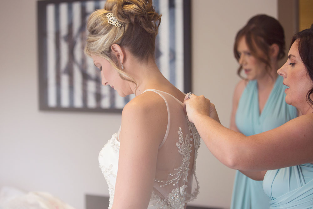 Ardoe House Hotel wedding, bride putting the dress on, Anna Wytrazek Photography, wedding photographer Aberdeen