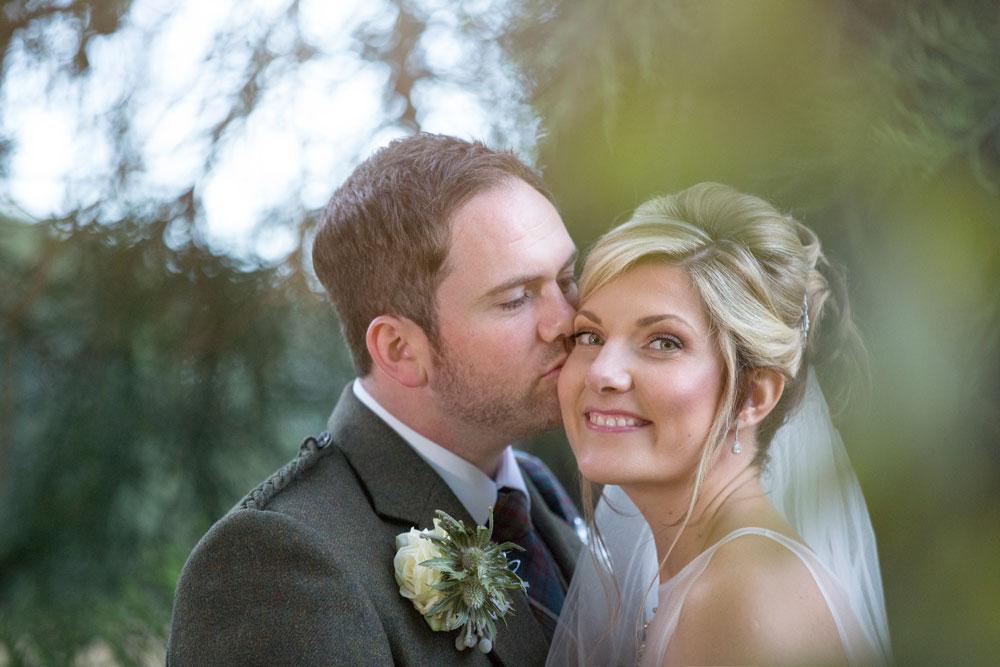 Ardoe House Hotel wedding, groom kissing bride, Anna Wytrazek Photography, wedding photographer Aberdeen