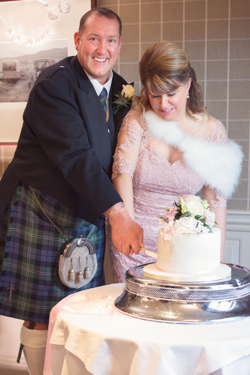 Thainstone House Hotel Wedding, cutting the cake, Anna Wytrazek Photography, Wedding-Photographer-Aberdeen