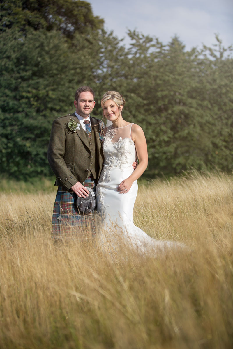 Ardoe House Hotel Wedding Aberdeen, bride and groom on the field, Anna Wytrazek Photography