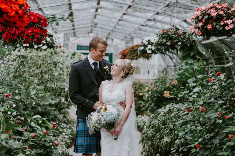 Duthie Park Winter Gardens Wedding, Bride and Groom looking at each other, Anna Wytrazek Photography, Wedding photographer Aberdeen