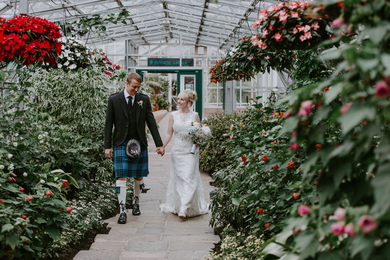 Duthie Park Winter Gardens Wedding, Bride and Groom walking and smiling, Anna Wytrazek Photography, Wedding photographer Aberdeen